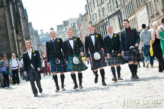 Mixing different tartans. Kilts and morning suit on groomsmen, on Edinburgh Royal Mile