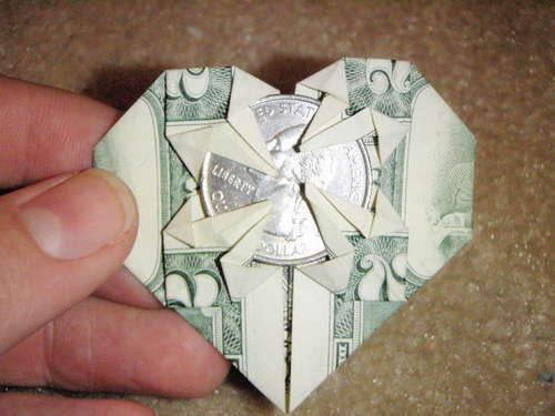 Origami dollar heart...really easy! I DID IT!!!! But I used a Texas quarter since my brother is in Texas and I'm sending him a candy box of money! :D