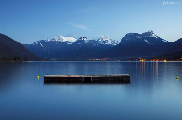 Springtime dusk on Annecy lake in Talloires. France, Haute Savoie department.