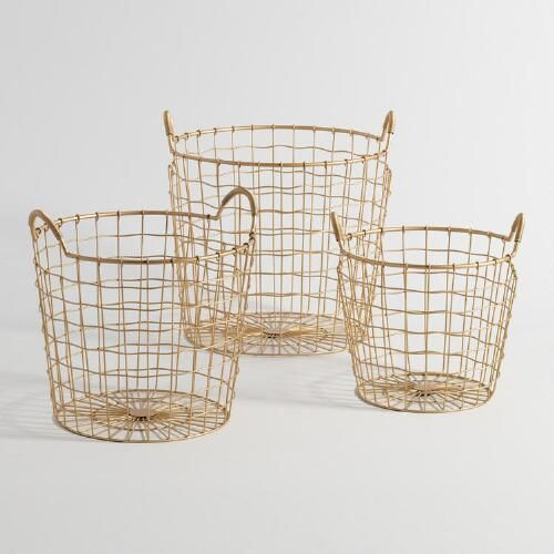Featuring wire-wrapped handles and a slightly wavy weave, our gold metal baskets in three sizes exude effortless glamour while keeping clutter contained from the entryway to the office.