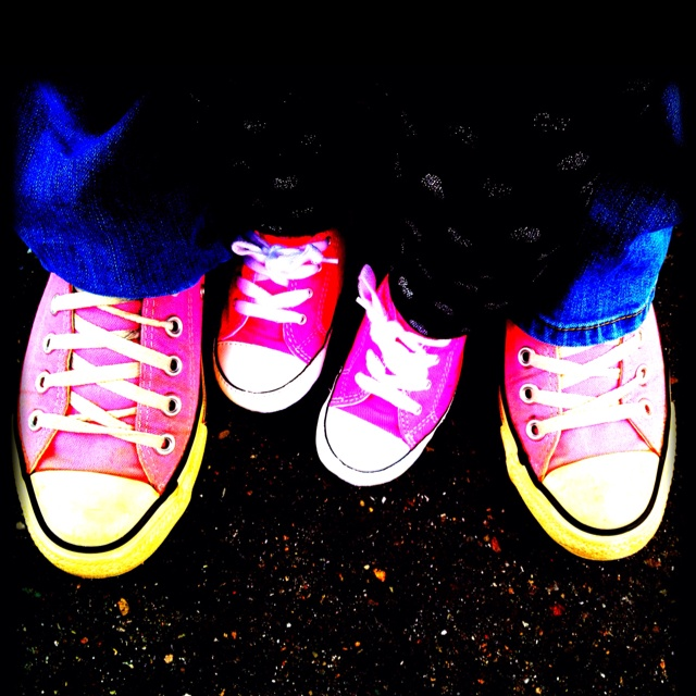Mom and daughter matching pink chucks.