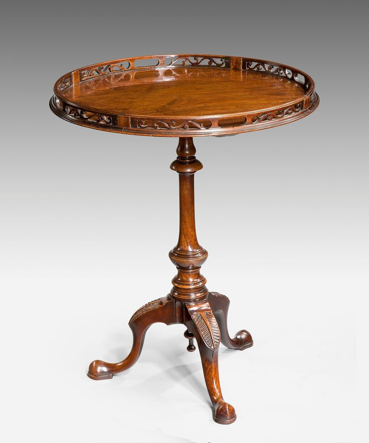 a chippendale tripod table with original fretwork gallery