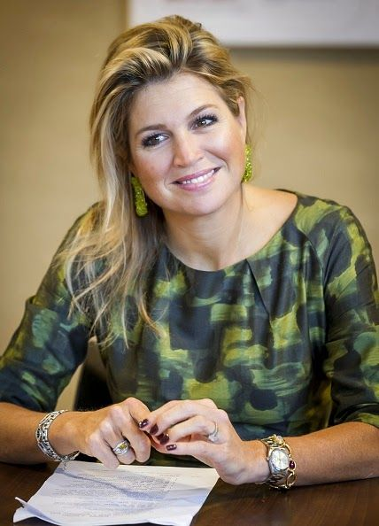 Dutch Queen Maxima speaks with volunteers during a visit to the sympathized family Foundation in Doorn on 17.10.2014. The foundation has developed a concept that parents with a psychiatric problem get the support of a sympathized family for their child aged 0 to 4 years.