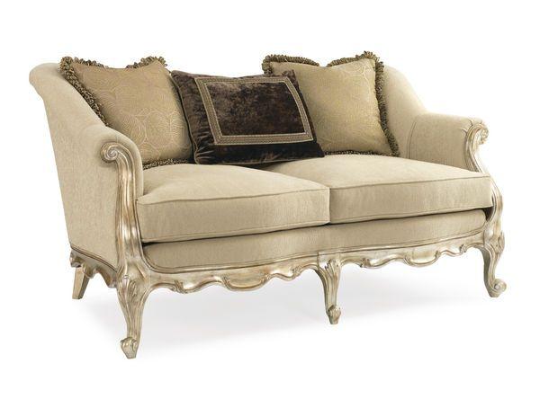 Изящный двухместный диван Elysia на гнутых ножках мерцающего золотого оттенка.             Метки: Маленькие диваны.              Материал: Ткань, Дерево.              Бренд: Schnadig.              Стили: Классика и неоклассика.              Цвета: Бежевый.