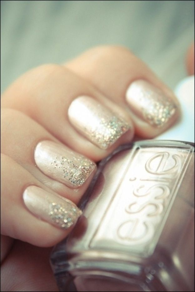 Ombre glitter wedding nails: Sprinkle a bit of glitter or sparkly eyeshadow at the very tips of your nails and let it diffuse downward; use a Q-tip to wipe up the excess.
