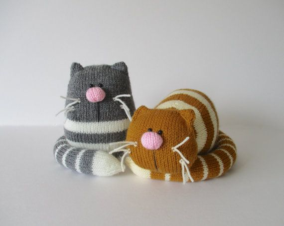 GINGER AND SMUDGE TOY CATS KNITTING PATTERNS  A pair of lazy fat cats! Ginger, the orange striped cat, is having a little rest (well it is hard work being a cat), and he could make a sweet doorstop. Smudge is the grey sitting cat, and you could use him as a bookend.  PLEASE NOTE: The price is for the knitting patterns only so you can make your own cats; you are not buying the finished toys. THE PATTERN INCLUDES: Row numbers for each step so you don't lose your place, instructions for making…
