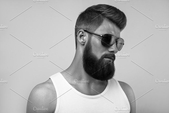 Bearded man portrait on white by Usmanov Stock Photography on @creativemarket