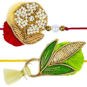 Set of 2 zardozi rakhis. These splendid set of rakhis are smartly made using zardozi and white pearls, neatly hand-woven with thread giving these rakhis a colorful look. Rs 436/- http://www.tajonline.com/rakhi-gifts/product/rdr77/zardozi-rakhi-set-of-2/?aff=pint2014/