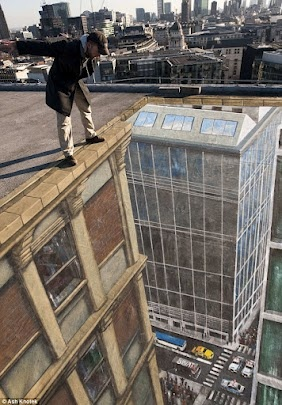 This looks real.. So crazy. 3d street art