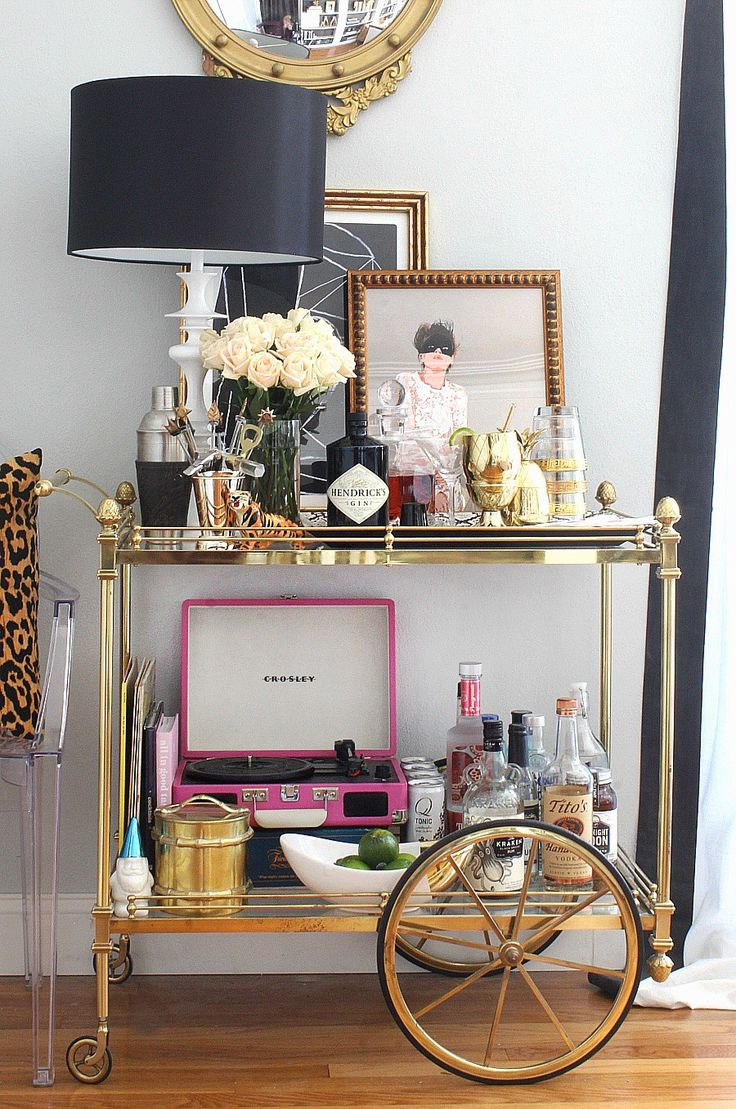 Bar Cart Styling & Tips featuring Mintwood Home | brass bar cart | leaning art | ghost chair | leopard pillow
