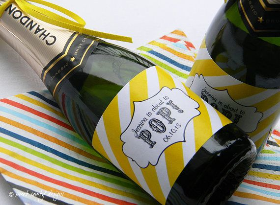 Super cool. We could pass out mini champagnes and ask everyone to open when the baby is born.  Set of Custom Mini Champagne Bottle Labels  You by sweetsanity, $13.00
