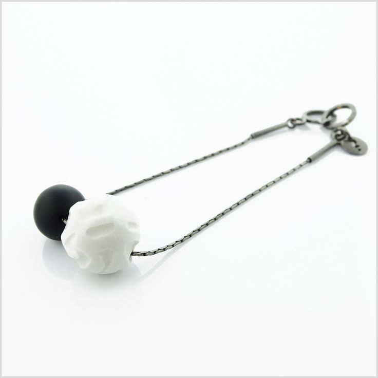 Bracelet from SUM - IN collection. Very original in minimalist style made of silver, porcelain and onyx ball designed by famous polish artist Bogdan Kosak.