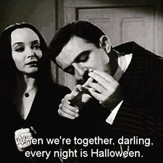 Morticia and Gomez Addams.The perfect couple, especially on Halloween. :D