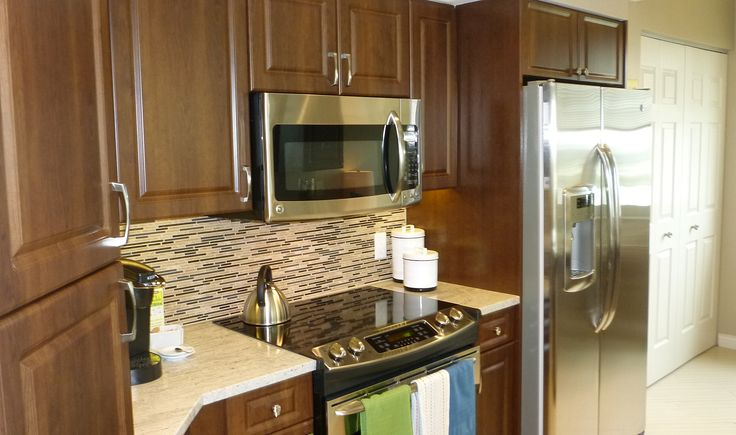 Here's A Kitchen With Walnut Cabinets, Stainless