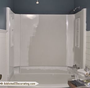 diy painted bathtub, bathroom ideas, painting, The first coat of paint going on You can see how dingy and drab the color of the tub was compared to the bright white paint