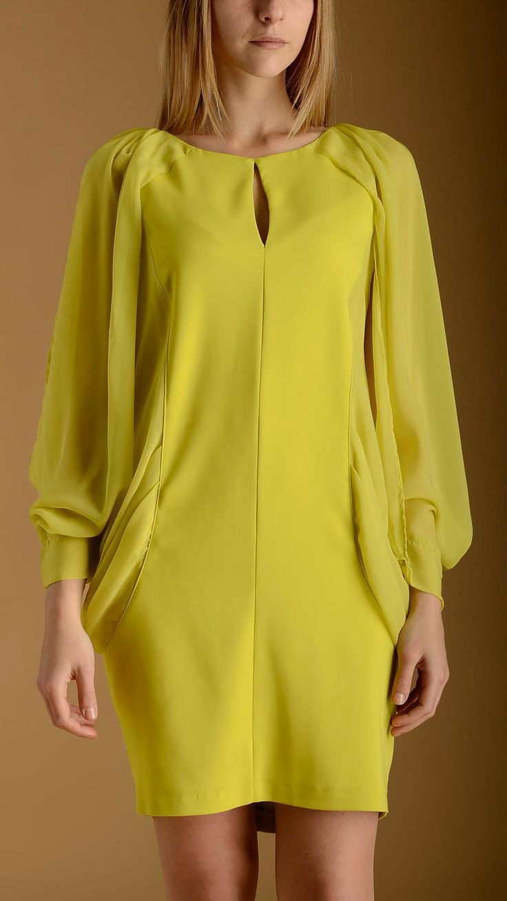 Atos Lombardini Kimono open-sleeves embellished lime dress featuring key-hole detail at front, georgette see-throught detail on the sleeves, two faux pockets, back key-hole with buttons and lace-ups closure, knee lenght.