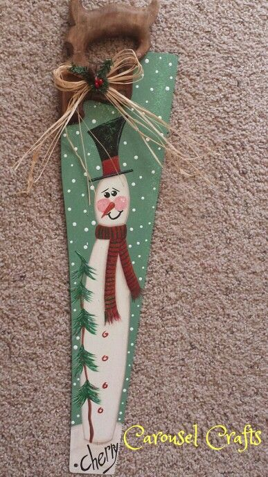 Painted old saw with a snowman