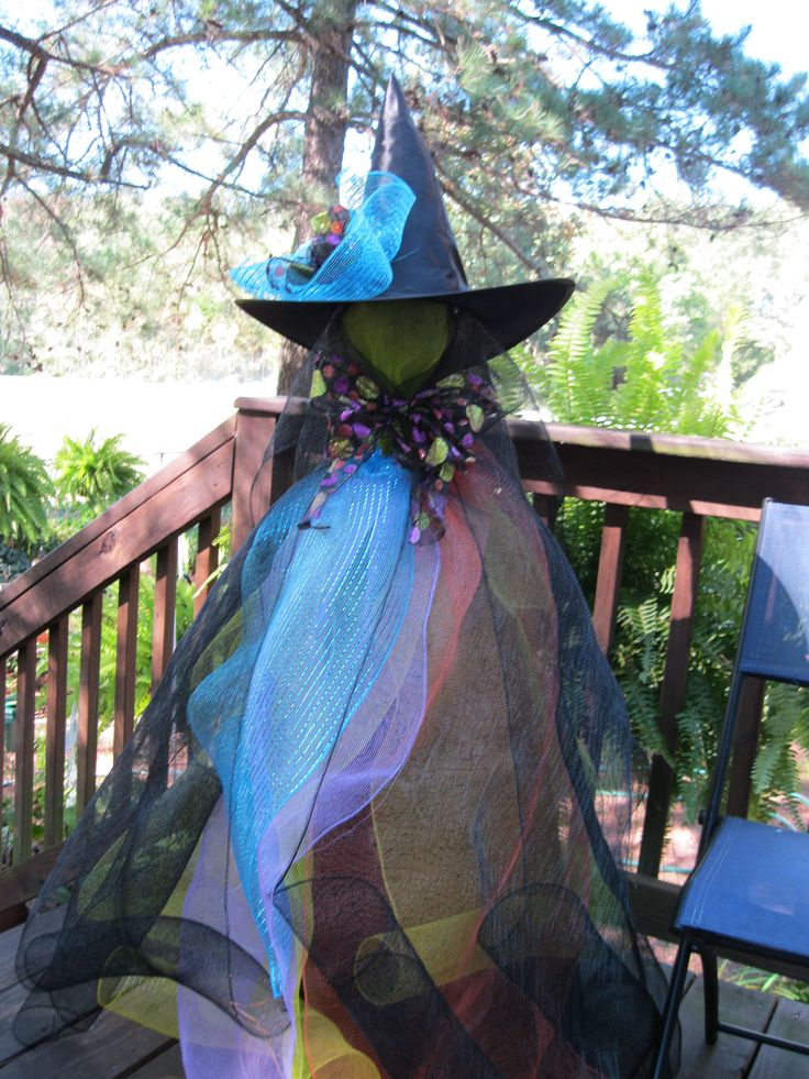 Witch: Very easy. Tomato cage, Dollar Store hat, fishing line, ribbon, deco mesh.