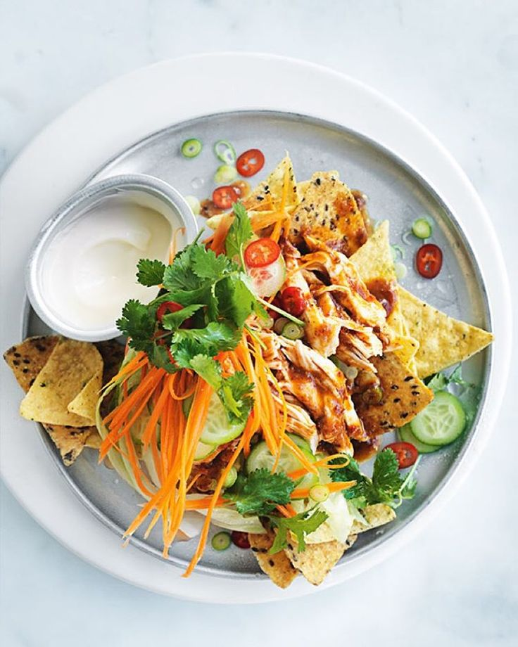 I've put a fresh new spin on the classic bowl of nachos, using seeded corn chips for a lighter crunch and shredded chilli chicken for a spicy Asian influence – just the thing for a quiet night on the couch with my boys! Find the recipe in the link in profile and have a good night! Dx