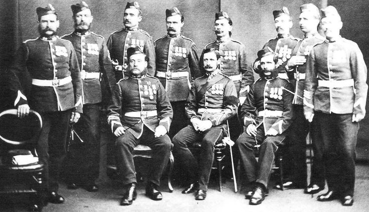 Crimean War Veterans James William Randall 4172 is second standing from the right and Edwin Lambert 4812 is 4th Man from the right standing. Royal Welsh Fusilier Edwin Lambert 4812 Born Dorset 1835 died 1915 age 80.