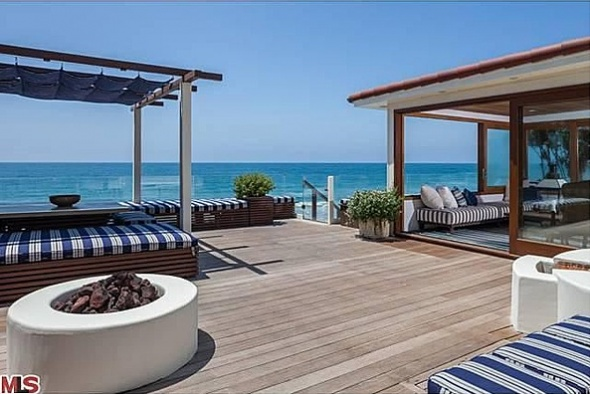 the-homes-best-feature-is-this-outdoor-water-front-deck-with-lounge-cabana-spa-fire-pit-and-outdoor-shower