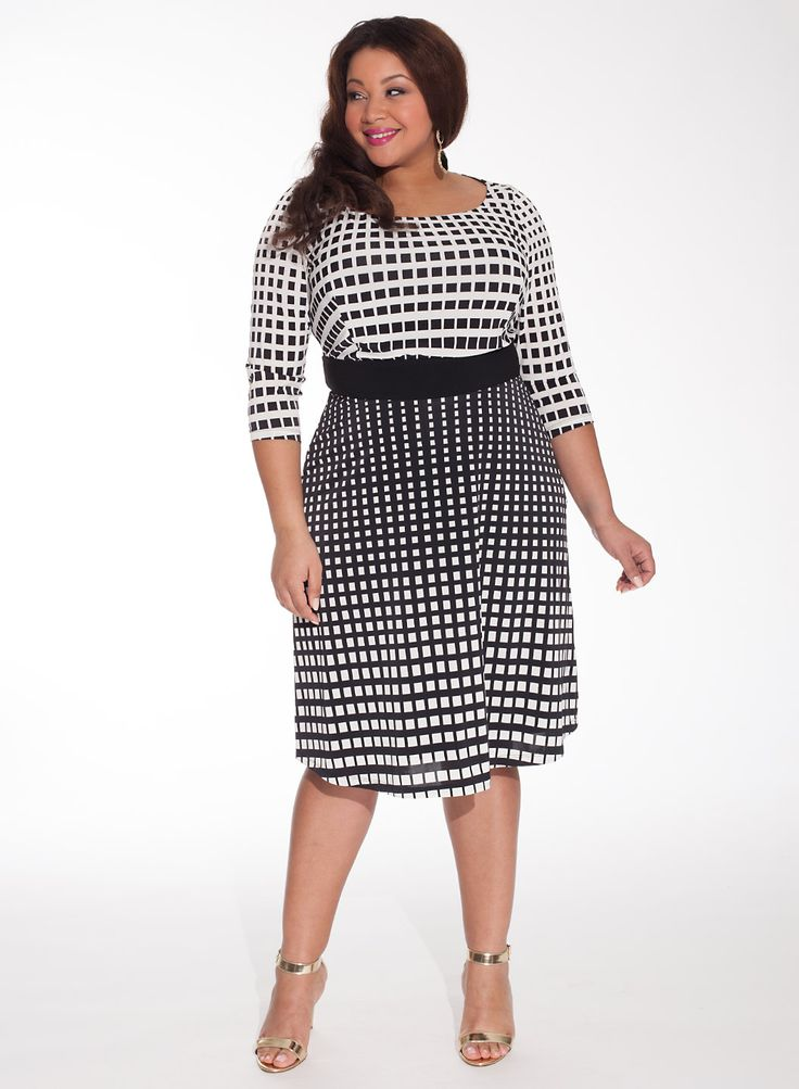 Plus size black dress with white polka dots