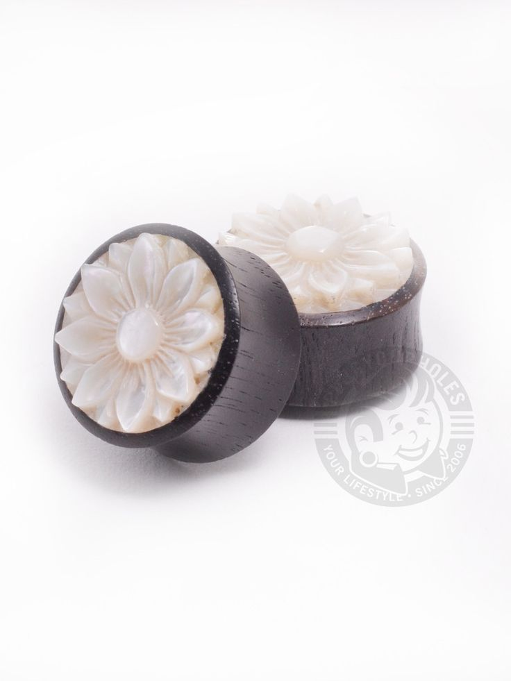 Mother Of Pearl Lotus Wooden Plugs. Great for your ears and easy on the nose, wood plugs are always a great idea. Try not to wear them in water, and make sure you keep them