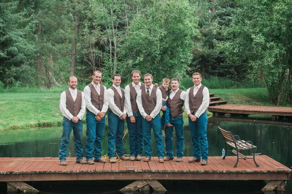 Laid-back groomsmen wedding attire - jeans with brown vests and white button downs {A+P Photography}