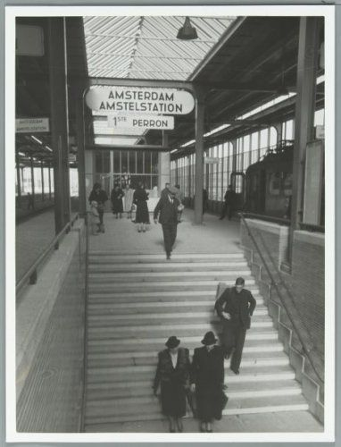 1939. Rail passengers on the stairs of the Amstel station in Amsterdam. The Amstel station (now Amsterdam Amstel) is a railway station located to the southeast of Amsterdam in the borough of Amsterdam-Oost, near the river Amstel. The station, which was built under the direction of architects Schelling and Leupen, opened in 1939. Nowadays Amsterdam Amstel is used daily by 50,000 train and metro passengers. Photo Spaarnestad / Wiel van der Randen #amsterdam #1940 #amstelstation.