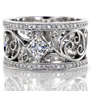 Lauren - This magnificent ring incorporates a unique free flowing filigree design that is truly eye catching. The design is framed on either side by a row of micro pavé diamonds with a 0.50 carat princess cut diamond in the center. The filigree pattern is enthralling with a sense of movement, a truly stunning design.