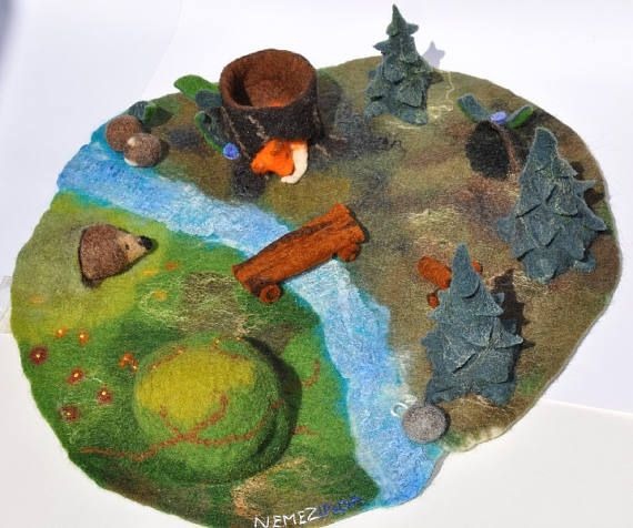 Woodland inspired landscape, play mat, play-mat with 3D elements: pine forest tree trunk small and larger caves stream flowers pebbles Ideal for your season table and for you/for your children to play stories on it. The dimensions of this medium size landscape: diameter of 39 cm = 15 inches Height of the pine and cave: about 10-12 cm / 4 - 4,5 You can watch step motion video at my Instagram profile or Youtube channel: https://www.instagram.com/p/BU9Hp6agR...