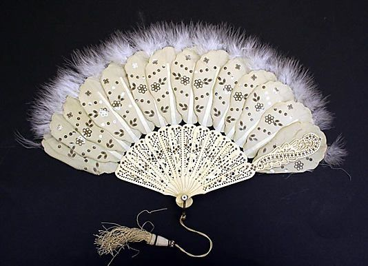 Circa 1860-1870 Brisé fan: Silk, Ivory, Feathers, and Metal, American or European.