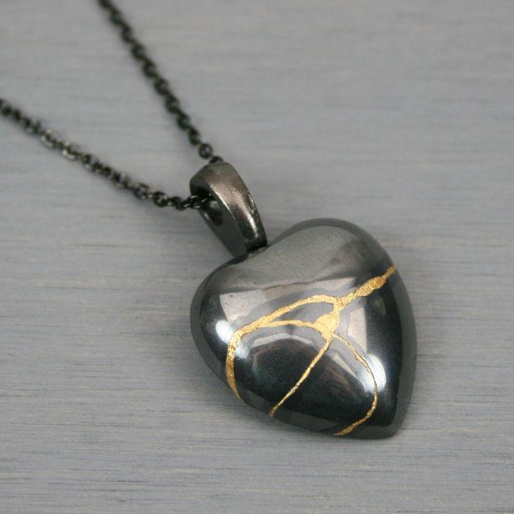 Hematite broken heart pendant with kintsugi repair on