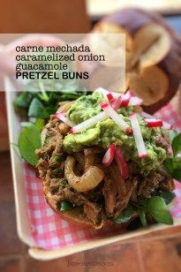 Fiesta lunch! Leftover pulled pork pretzel buns topped with some caramelized onion and a dollop of guacamole.