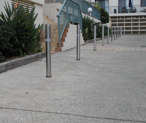 Vogue 80NB fixed in situ designer bollards. High Visibility reflective tape also added to the bollards. Flat top on bollards