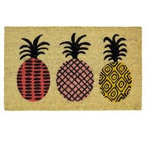Room Essentials Pineapple Doormat. Bold prints in vibrant lavender, pink and golden yellow add eclectic energy to the playful pineapples of the Room Essentials Pineapple Doormat.  This designer doormat is quality constructed of 100% coir, derived from the fibers of coconuts grown in South India, and is held securely in place by a sturdy vinyl backing.  The natural coir texture inherently whisks away dirt and debris from shoes keeping your indoor floors clean and tidy!