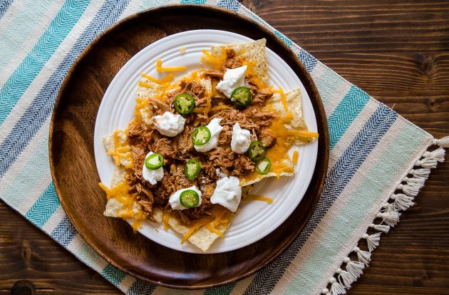 Shredded chicken nachos for two - this is the meal that'll get you through game day or Tuesday and consider it a win. Top it however you like!