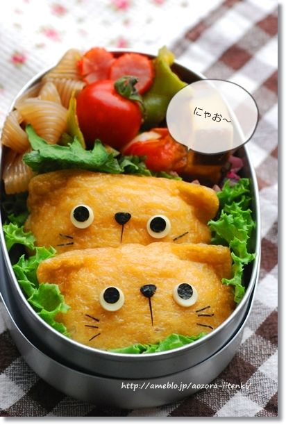 Cat inarizushi bento.  I don't know what this is, but she would love the cats