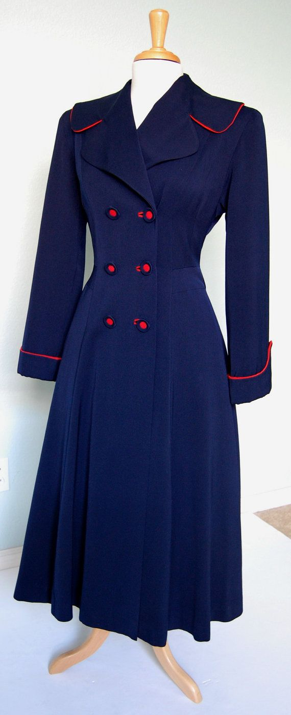 Whats not to love about this 1940s red and navy double breasted princess coat?