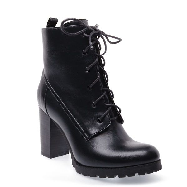 Black boot with stacked heel, black laces and cleated sole.