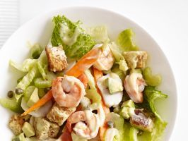 Seafood Salad : By blending avocado with lemon juice, caper brine and just a touch of mayo, you can give this seafood salad a creamy dressing without a ton of fat or calories.