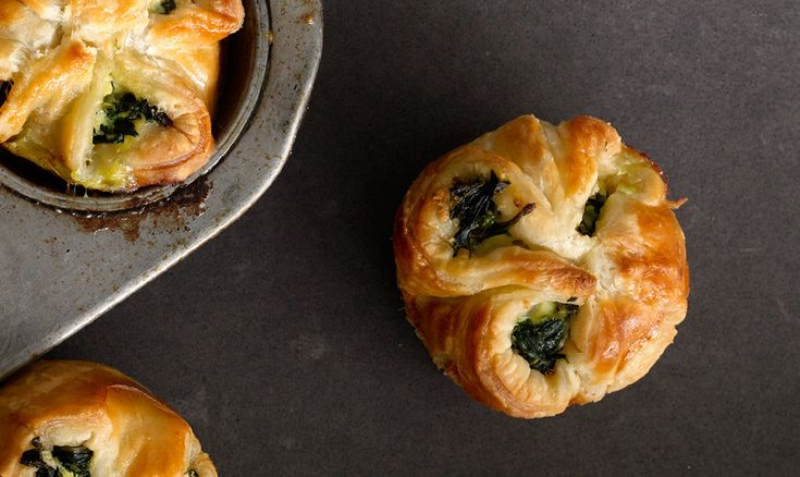 Spinach and feta arrive in tiny puff-pastry packages. #Spinach #Feta #Mini #Puffs #MuffinPan