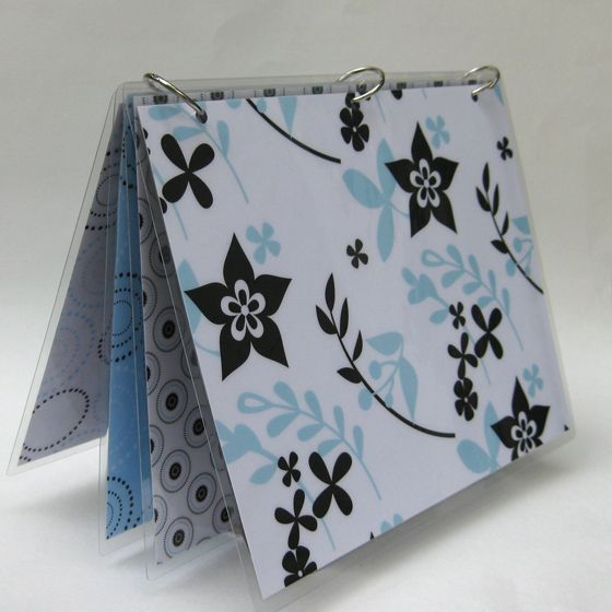 Handmade binder with scrapbook papers laminated and metal rings - personalize as desired.