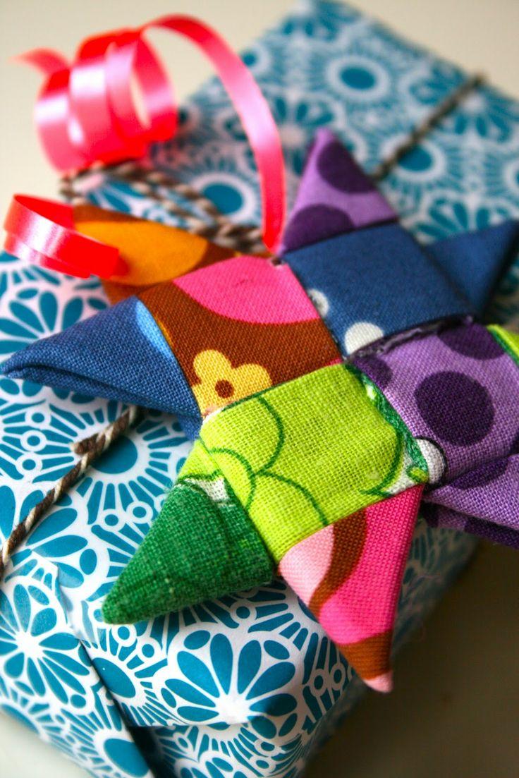such pretty folded fabric stars! Hang them on the tree.....make a garland.........random decorating!