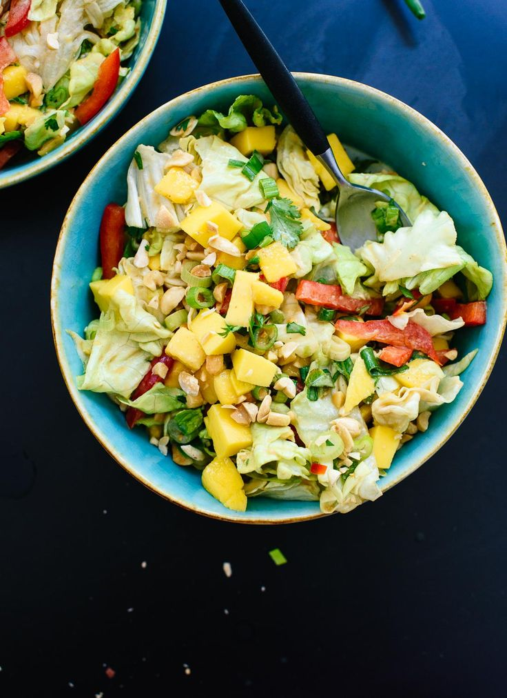 Fresh Thai green salad with sweet mango, bell pepper and a spicy peanut…