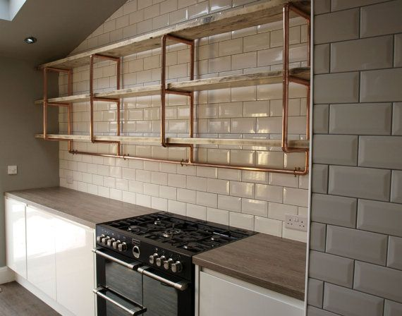 Everything in our shop and on our website can be made to the size and style that suites your home or business best.... Just get in touch for a free no obligation quote. Depth 33.5 cm x Width 190 cm x Height 90 cm (Depth is approx distance from wall to front of copper frame) (Height is distance from top to bottom of copper frame) A large wall mounted shelving unit made from copper pipe and reclaimed pine boards. This industrial/urban, vintage style piece is available with shelves in a v...