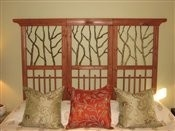 DIY king size headboard made from Lowes garden trellis lattice panels.