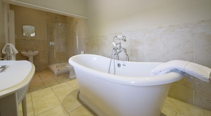 Bathroom decor, freestanding bath. Queen suite - Langdon court, manor house hotel Devon.