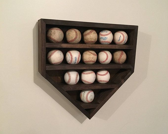 What better way to display those home run balls or those balls signed by famous players? Whether its a baseball themed room or just your living room, this baseball display is a great way of letting people see your special baseballs. This baseball holder is complete with 10 spaces for balls and 4 spaces for baseball bats. The home plate display is made from pallet wood and put together with wood glue and a pneumatic nail gun. With it being pallet wood, which means its repurposed, there are…