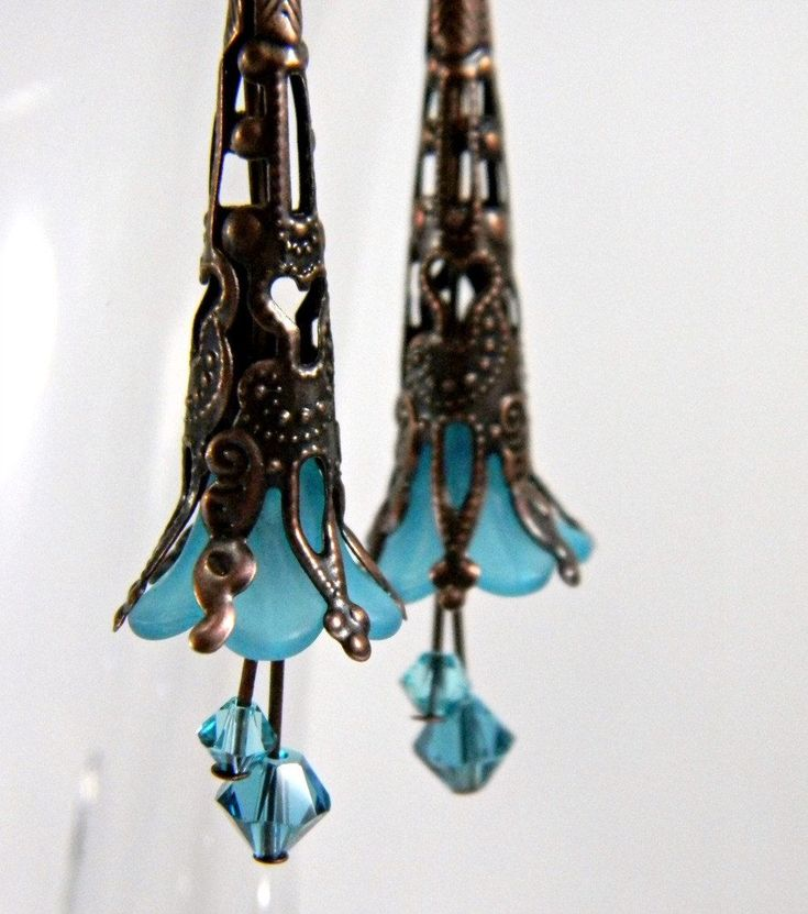 Teal Fairy Earrings  Antique Copper Filigree Bead Cap & Lucite Flower with Turquoise and Indicolite Swarovski Crystals  Beaded Jewelry. $10.00, via Etsy.
